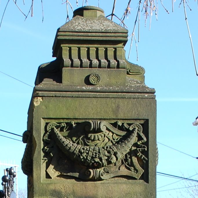 Carved stone gate post